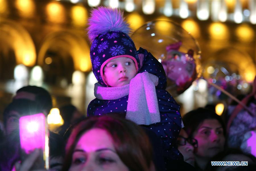People take part in the Christmas tree lighting ceremony at the downtown Republic Square, in Yerevan, Armenia, Dec. 21, 2018. (Xinhua/Gevorg Ghazaryan)
