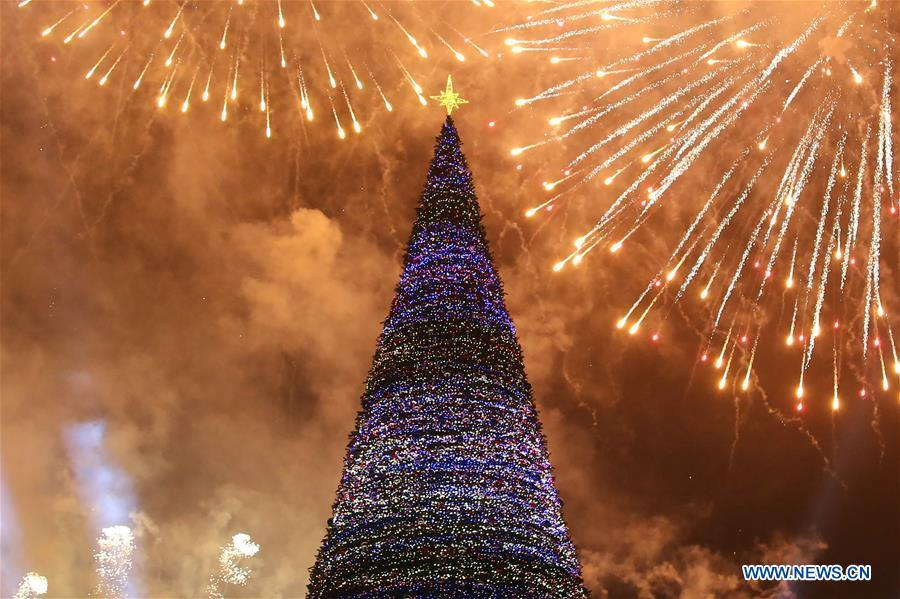 Photo taken on Dec. 21, 2018 shows the lit-up Christmas tree at the downtown Republic Square, heralding the start of New Year celebrations, in Yerevan, Armenia. (Xinhua/Gevorg Ghazaryan)