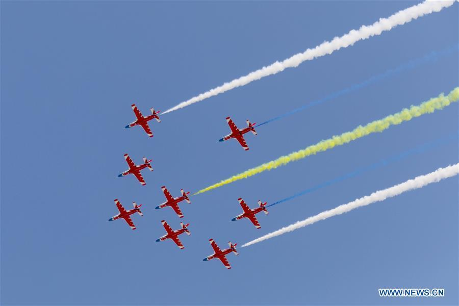 China\'s Hongying (Red Eagle) Aerobatic Team perform at the 12th China International Aviation and Aerospace Exhibition (Airshow China) in Zhuhai, south China\'s Guangdong Province, on Nov. 7, 2018. The living and working scenes of Chinese people in the past year have created a series of amazing views, some of which formed geometric figures. Those photos tell the development and progress of the country in 2018. (Xinhua/Liu Fang)