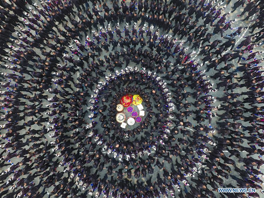 People of Dong ethnic group attend Duoye, a traditional celebrating activity, in Congjiang County, southwest China\'s Guizhou Province, Feb. 19, 2018. The living and working scenes of Chinese people in the past year have created a series of amazing views, some of which formed geometric figures. Those photos tell the development and progress of the country in 2018. (Xinhua/Zhang Qi)