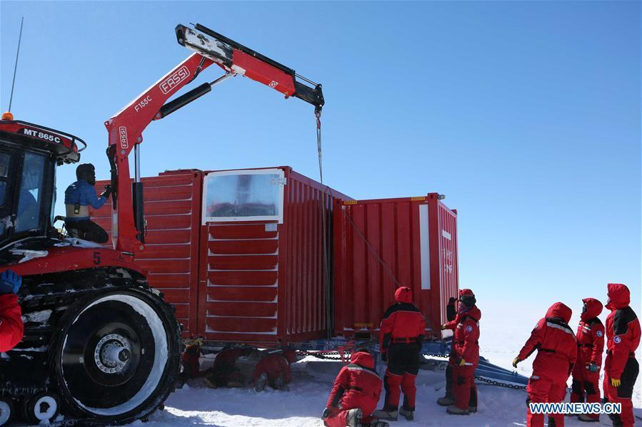 Members of two inland expedition teams maintain the equipment after a blizzard in Antarctica, Dec. 21, 2018. Two teams of Chinese researchers on China\'s 35th Antarctic expedition encountered a blizzard on their way to China\'s Kunlun and Taishan stations on Friday. (Xinhua/Liu Shiping)