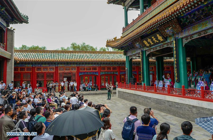 Tourists enjoy traditional opera at the Palace Museum in Beijing, capital of China, June 9, 2018. The Palace Museum, or the former imperial palace in downtown Beijing, will open 85 percent of its areas to the public, compared with the current 80 percent, the China Daily reported Friday. Most of the areas inside the museum, also known as the Forbidden City, will no longer be off-limits for the public, the newspaper quoted Shan Jixiang, the museum\'s curator, as saying. The biggest of its kind in the world, the Forbidden City is gradually opening more of its coverage of 720,000 square meters to visitors in recent years. Only 30 percent of its areas were accessible by the public in 2012. Some rooms that had not been opened for decades were used as \