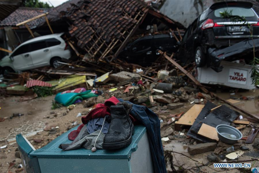 Clothes and a shoe are seen among debris after a tsunami hit Sunda Strait in Pandeglang, Banten province, in Indonesia, Dec. 23, 2018. The total casualty of a tsunami triggered by the eruption of Krakatau Child volcano has increased to 222 people in coastal areas of Sunda Strait of western Indonesia, disaster agency official said here on Sunday. The catastrophe killed at least 222 people, wounded at least 843 ones and collapsed a total of 556 houses and nine hotels, and caused damages to scores of ships. (Xinhua/Veri Sanovri)