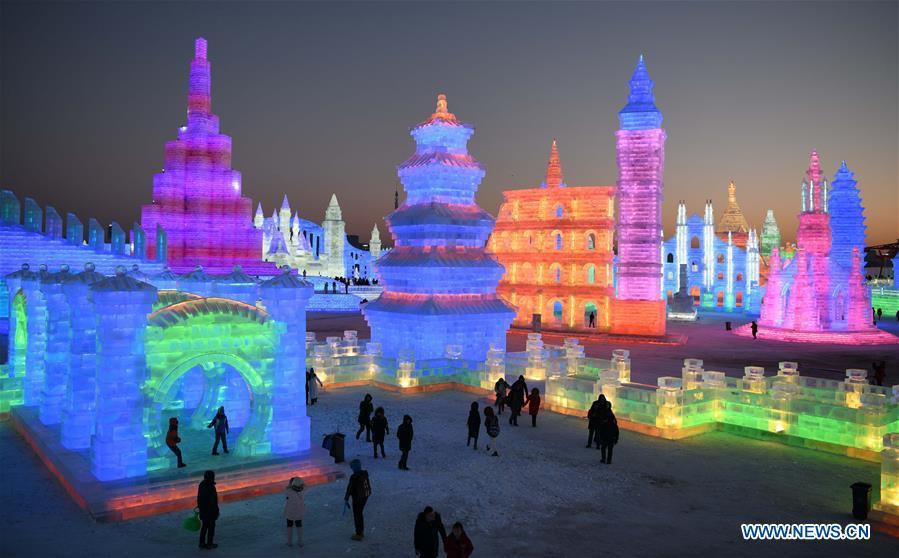 Tourists visit the Ice-Snow World in Harbin, capital of northeast China\'s Heilongjiang Province, Dec. 23, 2018. The Ice-Snow World opened on Sunday in Harbin. Covering an area of 600,000 square meters, the park used 110,000 cubic meters of ice and 120,000 cubic meters of snow this year. (Xinhua/Wang Jianwei)
