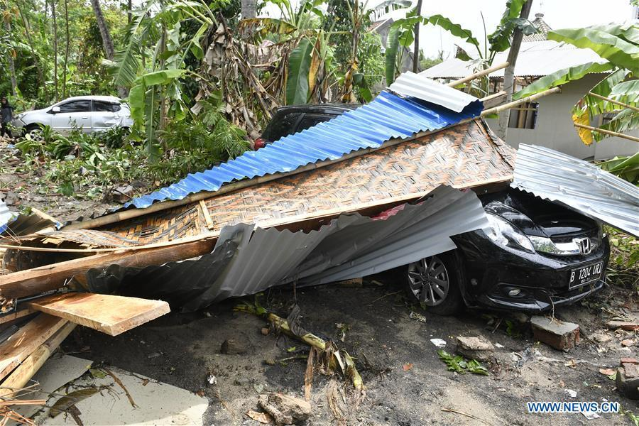 A car is buried in debris after a tsunami hit Sunda Strait in Pandeglang, Banten province, in Indonesia, Dec. 23, 2018. The total casualty of a tsunami triggered by the eruption of Krakatau Child volcano has increased to 168 people in coastal areas of Sunda Strait of western Indonesia, disaster agency official said here on Sunday. The catastrophe killed at least 168 people, wounded at least 745 ones and collapsed a total of 430 houses and nine hotels, and caused damages to scores of ships. (Xinhua/Wahyu Wening)