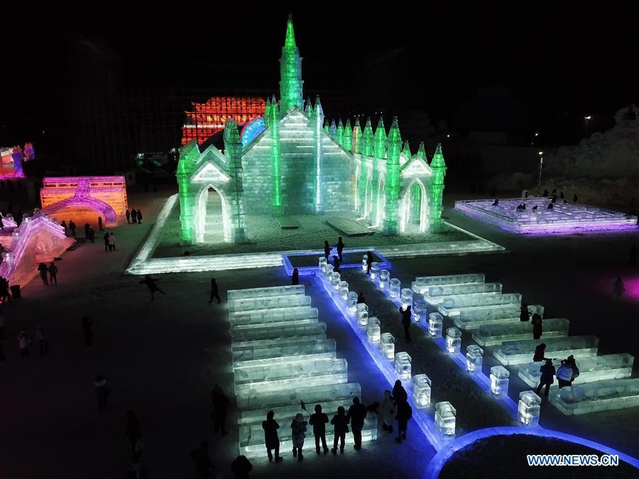 Aerial photo shows tourists visiting the Ice-Snow World in Harbin, capital of northeast China\'s Heilongjiang Province, Dec. 23, 2018. The Ice-Snow World opened on Sunday in Harbin. Covering an area of 600,000 square meters, the park used 110,000 cubic meters of ice and 120,000 cubic meters of snow this year. (Xinhua/Wang Song)