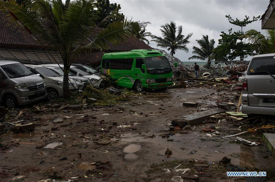 Vehicles are seen among the debris after a tsunami hit Sunda Strait in Pandeglang, Banten province, in Indonesia, Dec. 23, 2018. The total casualty of a tsunami triggered by the eruption of Krakatau Child volcano has increased to 222 people in coastal areas of Sunda Strait of western Indonesia, disaster agency official said here on Sunday. The catastrophe killed at least 222 people, wounded at least 843 ones and collapsed a total of 556 houses and nine hotels, and caused damages to scores of ships. (Xinhua/Veri Sanovri)