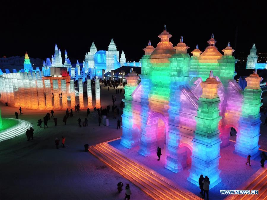 Tourists visit the Ice-Snow World in Harbin, capital of northeast China\'s Heilongjiang Province, Dec. 23, 2018. The Ice-Snow World opened on Sunday in Harbin. Covering an area of 600,000 square meters, the park used 110,000 cubic meters of ice and 120,000 cubic meters of snow this year. (Xinhua/Wang Song)