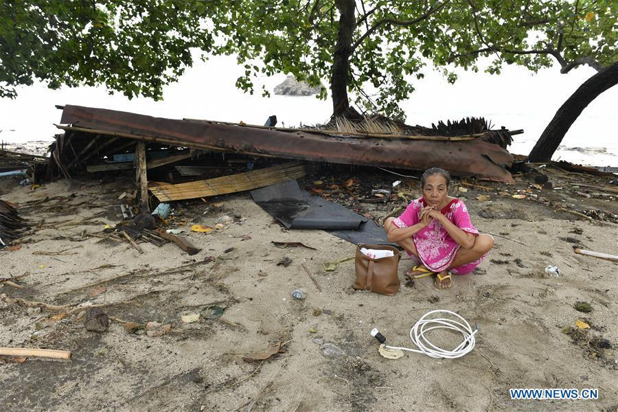 A woman sits by the debris of her kiosk near the beach in Carita after a tsunami hit Sunda Strait in Pandeglang, Banten province, in Indonesia, Dec. 23, 2018. The total casualty of a tsunami triggered by the eruption of Krakatau Child volcano has increased to 168 people in coastal areas of Sunda Strait of western Indonesia, disaster agency official said here on Sunday. The catastrophe killed at least 168 people, wounded at least 745 ones and collapsed a total of 430 houses and nine hotels, and caused damages to scores of ships. (Xinhua/Wahyu Wening)