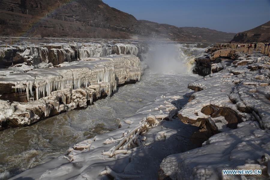 Icicles are seen at the Hukou Waterfall of the Yellow River in Jixian County, north China\'s Shanxi Province, Dec. 23, 2018. (Xinhua/Lyu Guiming)