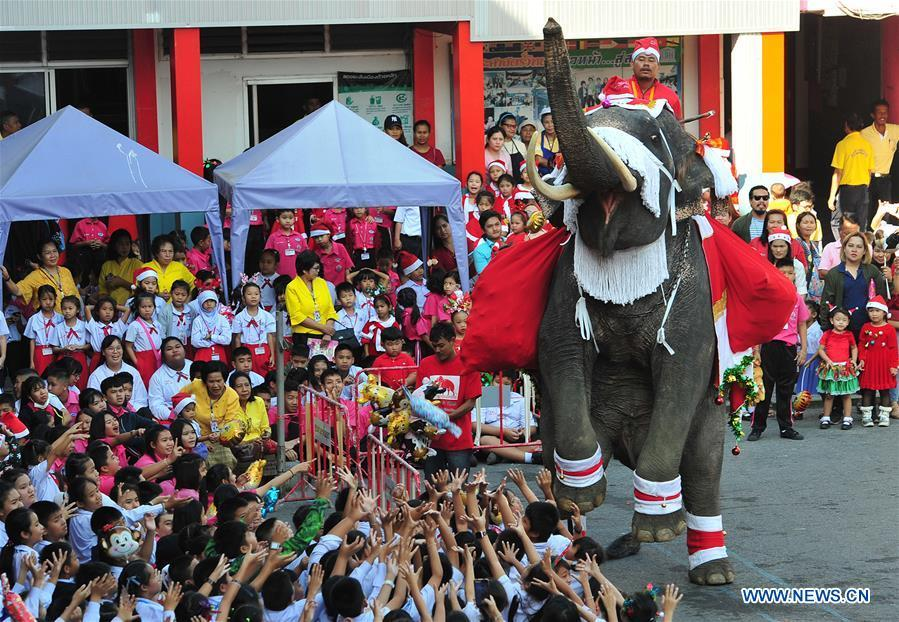 An elephant distributes gifts to students during Christmas celebrations at a school in Ayutthaya province, Thailand, Dec. 24, 2018. The annual event is held to celebrate Christmas and promote tourism in Ayutthaya. (Xinhua/Rachen Sageamsak)