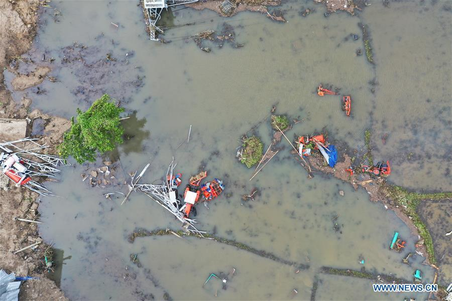 Aerial photo taken on Dec. 24, 2018 shows a farmland damaged by tsunami in Banten Province, in Indonesia, Dec. 24, 2018. The Indonesian disaster agency on Monday put the death toll of the tsunami triggered by a volcanic eruption at 373 with 1,459 others injured, a spokesman of the agency told Xinhua on Monday. (Xinhua/Du Yu)