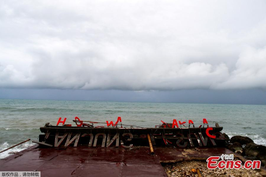 Remaining parts of an outdoor stage, where a rock band Seventeen was performing, which was hit by a tsunami, lay on a shore at a resort in Tanjung Lesung, Banten province, Indonesia, Dec. 24, 2018. Indonesian military and rescue teams fanned out across a stretch of coastline on Monday, hoping to find survivors of a tsunami triggered by a landslide from a volcano that killed at least 373 people. (Photo/Agencies)