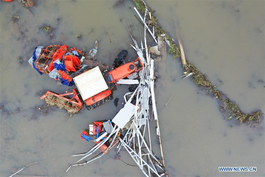 A farm machine is damaged by tsunami in Banten Province, in Indonesia, Dec. 24, 2018. The Indonesian disaster agency on Monday put the death toll of the tsunami triggered by a volcanic eruption at 373 with 1,459 others injured, a spokesman of the agency told Xinhua on Monday. (Xinhua/Du Yu)
