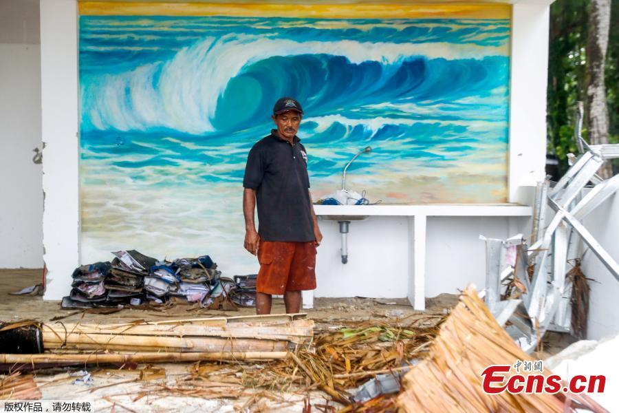 A worker stands in front of a mural inside a destroyed resort bar which was hit by a tsunami in Tanjung Lesung, Banten province, Indonesia, Dec. 24, 2018. Indonesian military and rescue teams fanned out across a stretch of coastline on Monday, hoping to find survivors of a tsunami triggered by a landslide from a volcano that killed at least 373 people. (Photo/Agencies)