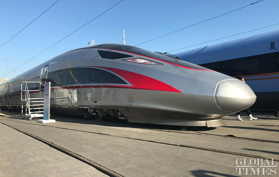 It can carry 1,823 passengers, making it 7.5 percent larger than the current Fuxing train\'s capacity. The new train will be put into service on rail lines between Beijing and Shanghai in January.  (Photos: Li Xuanmin/GT)