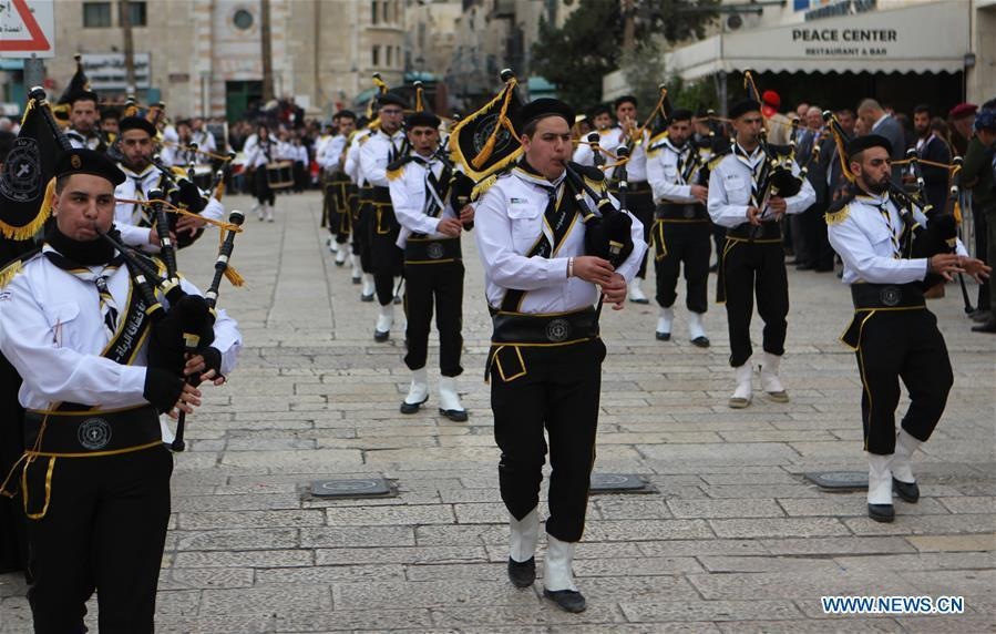 Palestinians perform outside the Church of the Nativity in the West Bank city of Bethlehem on Dec. 24, 2018. Thousands of Christian pilgrims gathered in Bethlehem\'s Manger Square to celebrate Christmas. (Xinhua/Mamoun Wazwaz)