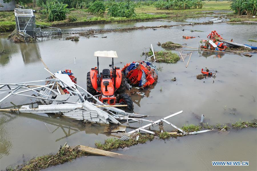 Farmland and farm machines are damaged by tsunami in Banten Province, in Indonesia, Dec. 24, 2018. The Indonesian disaster agency on Monday put the death toll of the tsunami triggered by a volcanic eruption at 373 with 1,459 others injured, a spokesman of the agency told Xinhua on Monday. (Xinhua/Du Yu)