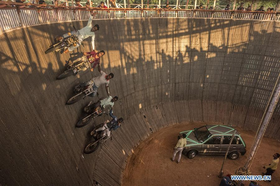 Stuntmen perform on their vehicles in a \