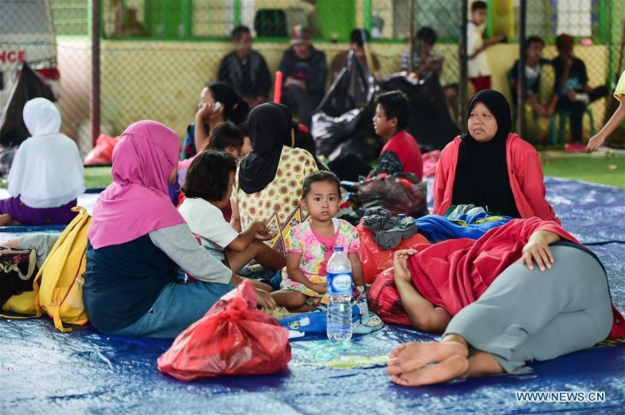 Tsunami survivors rest at a temporary shelter in Labuan of Pandeglang in Banten Province, Indonesia, Dec. 25, 2018. Casualty from the tsunami triggered by a volcanic eruption in Sunda Strait in Indonesia climbed to 429 people, and 16,802 others were displaced. (Xinhua/Du Yu)