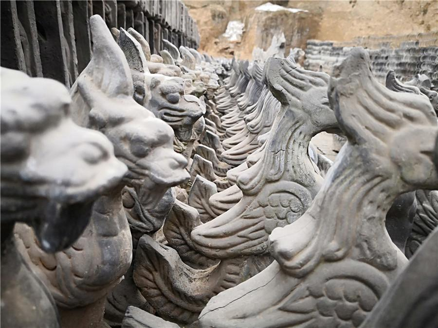 Sculptures of traditional mythical beasts.  (Photo by Wei Jianjun for chinadaily.com.cn)