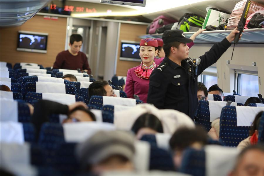 Liu and her colleagues check the luggage of passengers and inspect the carriage. (Photo provided to chinadaily.com.cn)
