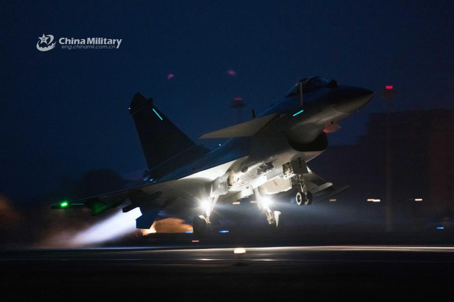 A J-10 fighter jet attached to an aviation brigade of the air force under the PLA Northern Theater Command takes off from a military airfield during a recent night flight training exercise.  (Photo/eng.chinamil.com.cn)