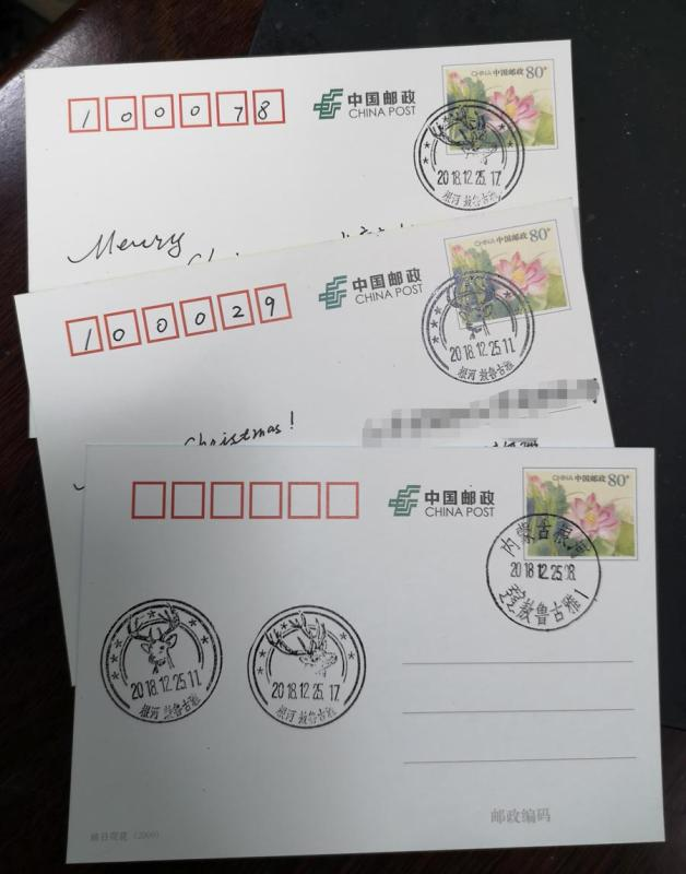 Tourists can send postcards with unique postmarks of reindeer patterns. (Photo/China Daily)