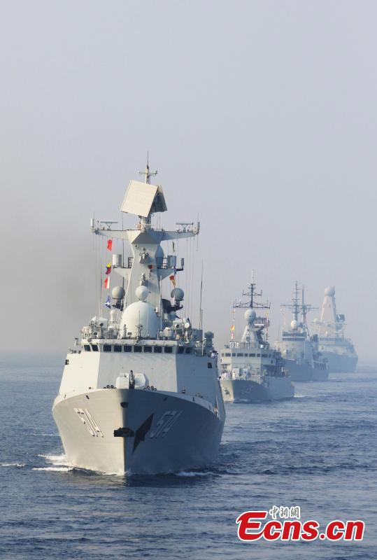 Warships from various countries sail in formation during a multinational joint navigation drill in India, Feb. 9, 2016. The guided-missile frigates Liuzhou and Sanya with the 21st Chinese naval escort taskforce conducted multinational joint navigation drill with warships from a few countries. (Photo: China News Service/ Zeng Xingjian)