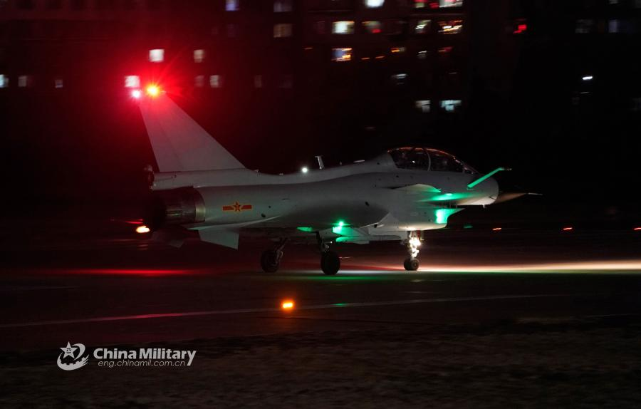 A J-10 fighter jet attached to an aviation brigade of the air force under the PLA Northern Theater Command taxis on the runway before takeoff during a recent night flight training exercise. (Photo/eng.chinamil.com.cn)