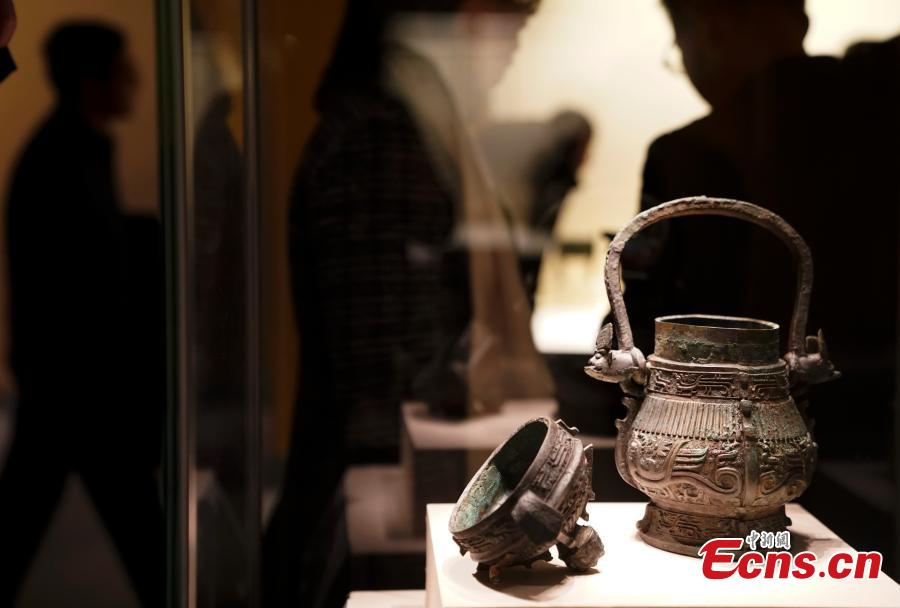 Cultural relics, including bronze wares and silver ingots, retrieved by police are on display at an exhibition at the National Museum of China in Beijing, Dec. 26, 2018. The exhibition displays 750 precious artifacts retrieved during police efforts in recent years fighting crime involving stolen cultural treasures, which hail from Neolithic times through to the Qing Dynasty. (Photo: China News Service/Du Yang)