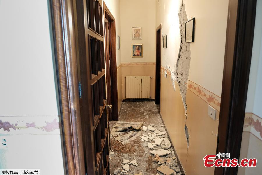 Debris cover the ground of damaged house in Zafferana Etnea near Catania on Dec. 26, 2018, after a 4.8-magnitude earthquake hit the area around Europe\'s most active volcano Mount Etna. The quake was the strongest in the region after Mount Etna erupted on Dec. 24. It injured four people, damaged old buildings and forced the closure of part of a highway running along the sea, Italian civil protection authorities said. (Photo/Agencies)