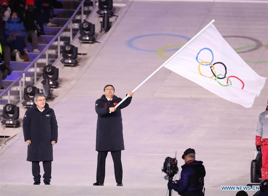 File photo taken on Feb. 25, 2018 shows Chen Jining (2nd L), mayor of Beijing, China, waves Olympic flag during the closing ceremony for the 2018 PyeongChang Winter Olympic Games at PyeongChang Olympic Stadium, PyeongChang, South Korea. The Olympic Winter Games have now officially entered \