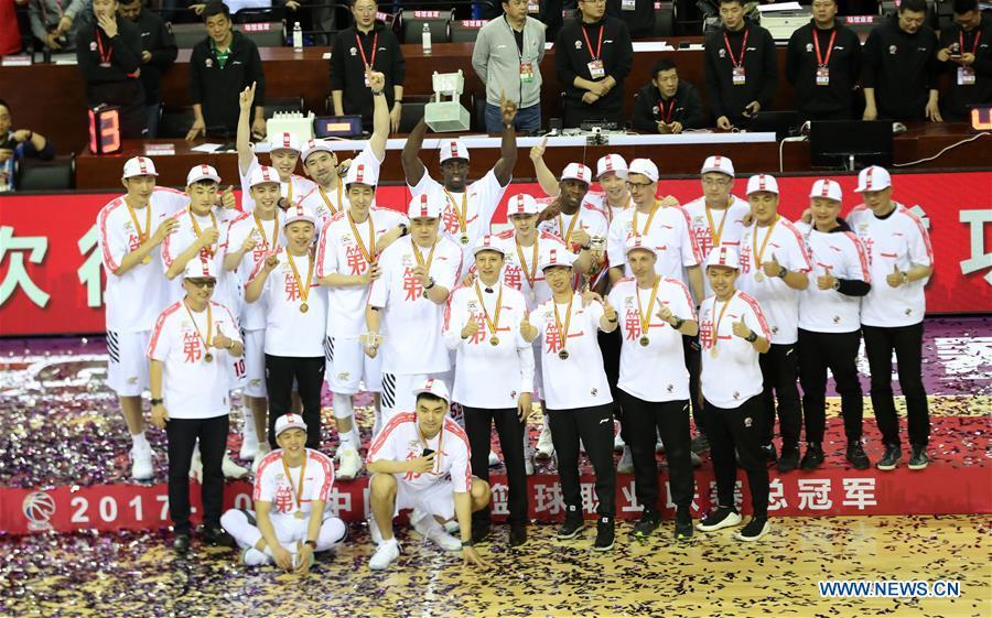 File photo taken on April 22, 2018 shows members of Liaoning team pose for pictures during the awarding ceremony for 2017-2018 Chinese Basketball Association (CBA) League in Shenyang, capital of northeast China\'s Liaoning Province. Liaoning won the CBA title as the seventh champion in the league history. (Xinhua/Li Gang)