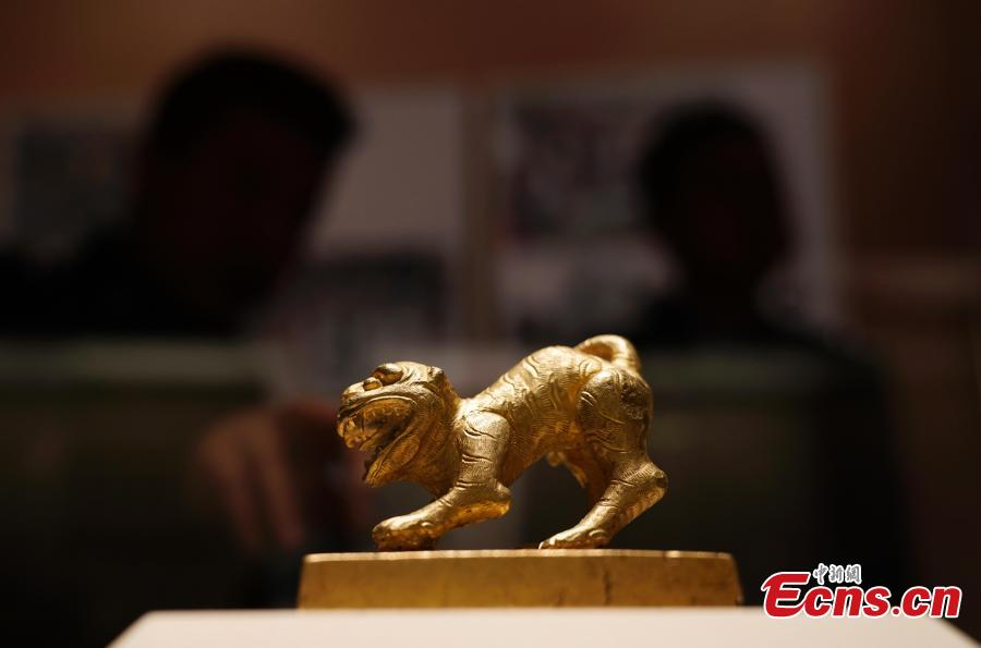 A gold seal from Meishan in Sichuan Province, used by rebels near the end of the Ming Dynasty (1368-1644), is on display at an exhibition at the National Museum of China in Beijing, Dec. 26, 2018. The exhibition displays 750 precious artifacts retrieved during police efforts in recent years fighting crime involving stolen cultural treasures, which hail from Neolithic times through to the Qing Dynasty. (Photo: China News Service/Du Yang)