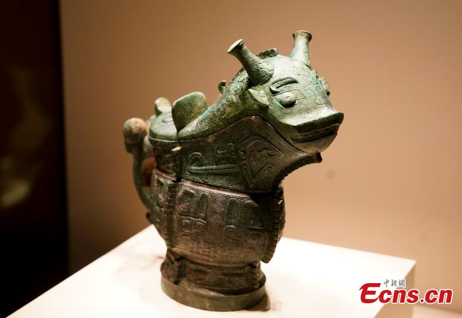 A bronze wine vessel retrieved by police after it was stolen from an ancient tomb in Wenxi of Shanxi Province is on display at an exhibition at the National Museum of China in Beijing, Dec. 26, 2018. The exhibition displays 750 precious artifacts retrieved during police efforts in recent years fighting crime involving stolen cultural treasures, which hail from Neolithic times through to the Qing Dynasty. (Photo: China News Service/Du Yang)