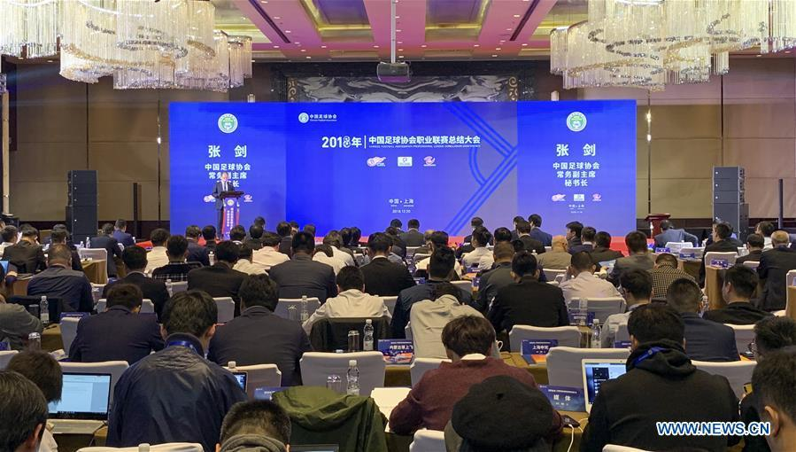 File photo taken on Dec. 20, 2018 shows people attending the Chinese Footbal Association Professional League Conclusion Conference in east China\'s Shanghai Municipality. The Chinese Football Association introduced more exacting regulations from next season to dampen spending by clubs, including a salary cap. The CFA has also decided to set standards for national team players and announced a plan to raise the level of women\'s football. (Xinhua/Ding Ting)