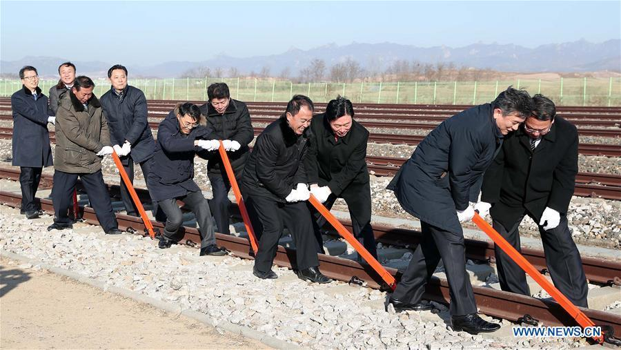 Guests take part in the groundbreaking ceremony for rail and road connection across border between South Korea and the Democratic People\'s Republic of Korea (DPRK) at Panmun Station in the DPRK\'s border town of Kaesong on Dec. 26, 2018. South Korea and DPRK on Wednesday held a groundbreaking ceremony to modernize and eventually connect railways and roads across the inter-Korean border. (Xinhua)