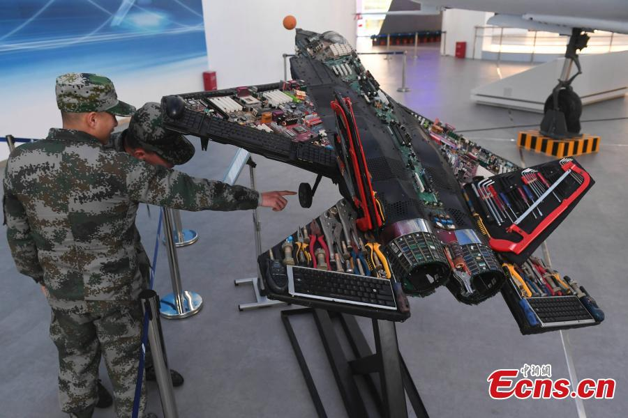 A aircraft model made using old components is on display at the Hunan Aviation Museum at the Changsha Aeronautical Vocational and Technical College in Changsha City, Central China's Hunan Province. The museum showcases aviation equipment, aviation technology and culture. It is also the national defense education base of Hunan. (Photo: China News Service/Yang Huafeng)