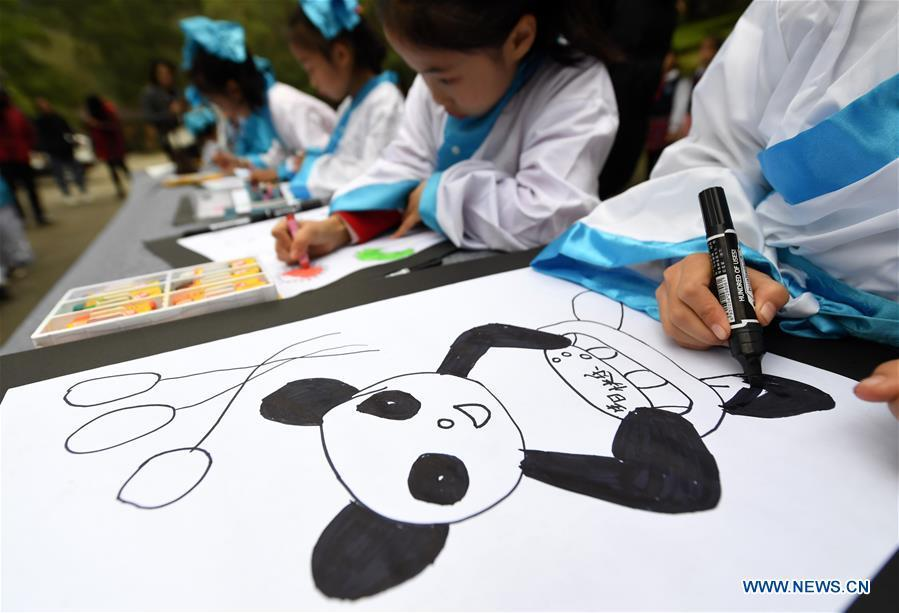 Children draw birthday cards for giant panda \