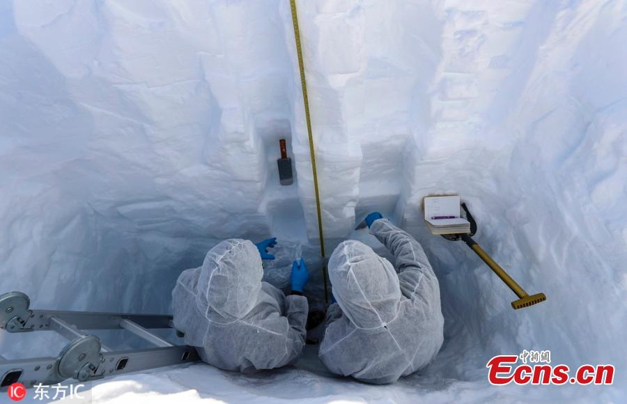 Scientists Juan Manuel Carrera (R) from Venezuela and Jose Jorquera (L) from Chile work inside a snow trial pit on the Union Glacier in the Ellsworth Mountains, Antarctica, Dec. 5, 2018. A group of eight researchers take part in the first activity of the LV Scientific Antarctic Expedition organized by the Chilean Antarctic Institute (INACH). The Glacier Union camp is a Chilean polar station operated by the three groups of the Armed Forces of Chile and the INACH, and marks the beginning of all scientific activities planned in the Antarctic territory for the summer season. Glacier Union is the third most southern camp of the continent and it is only open for a month. (Photo/Agencies)