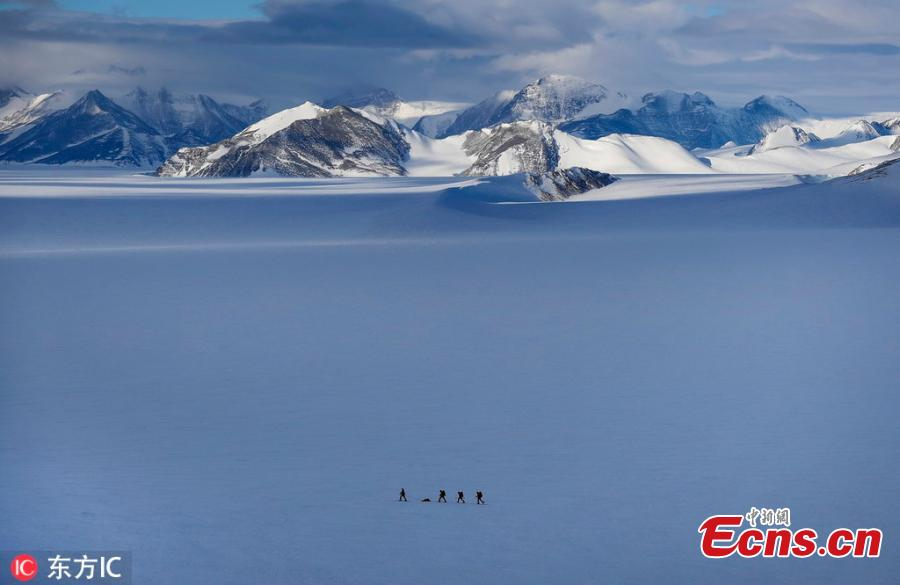 Chilean scientist Ricardo Jana (L) and a group of military explorers track an area with GPS near the Higgins Nunatak, on the Union Glacier in the Ellsworth Mountains, Antarctica, Nov. 29, 2018. A group of eight researchers is taking part in the first activity of the LV Scientific Antarctic Expedition organized by the Chilean Antarctic Institute (INACH). The Glacier Union camp is a Chilean polar station operated by the three groups of the Armed Forces of Chile and the INACH, and marks the beginning of all scientific activities planned in the Antarctic territory for the summer season. Glacier Union is the third most southern camp of the continent and it is only open for a month. (Photo/Agencies)