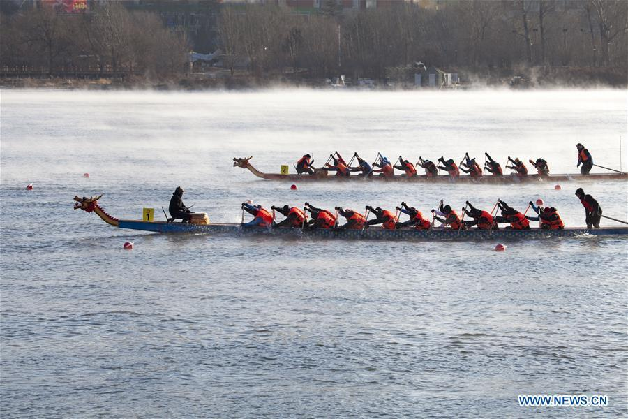 Teams of participants compete during a winter dragon boat race in Jilin City, northeast China\'s Jilin Province, Dec. 28, 2018. A total of 15 teams from home and abroad participated in the race on Friday. (Xinhua/Zhu Wanchang)