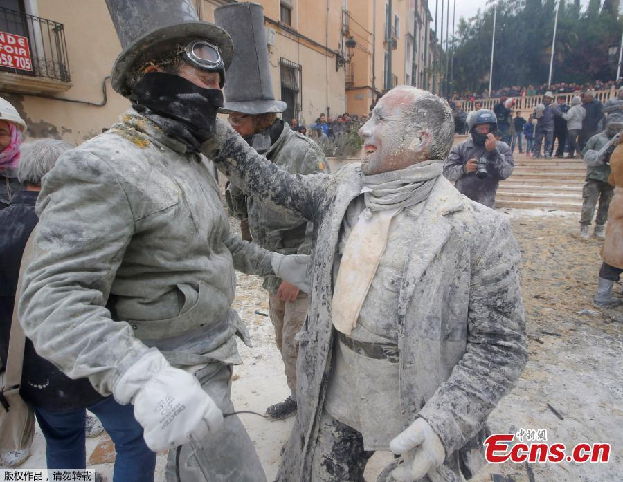 Revelers battle with flour and eggs during the traditional \