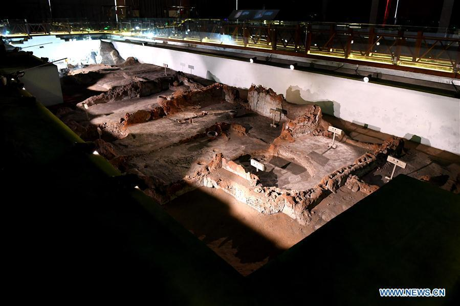 Picture taken on Dec. 11, 2018 shows the foundation of a Neolithic house in the Dahe Village relic site museum in Zhengzhou, capital of central China\'s Henan Province. The foundations of a Neolithic house that has stood for over 5,000 years in central China\'s Henan Province will be examined and reinforced 46 years after they were unearthed. The four-bedroom home is part of the Neolithic Yangshao culture, dating back 7,000 years. (Xinhua/Li An)
