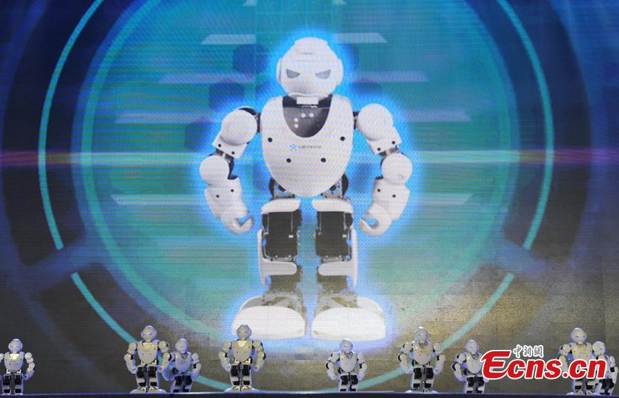 A team of Titan robots perform at the finals of the First National Intelligent Sports Competition in Hangzhou, Zhejiang Province, Dec. 29, 2018. More than 1,400 finalists from across China will compete in 13 intelligent sports, including cycling, racing, golf, and shooting, in the following 2 days. (Photo: China News Service/Zhang Yin)