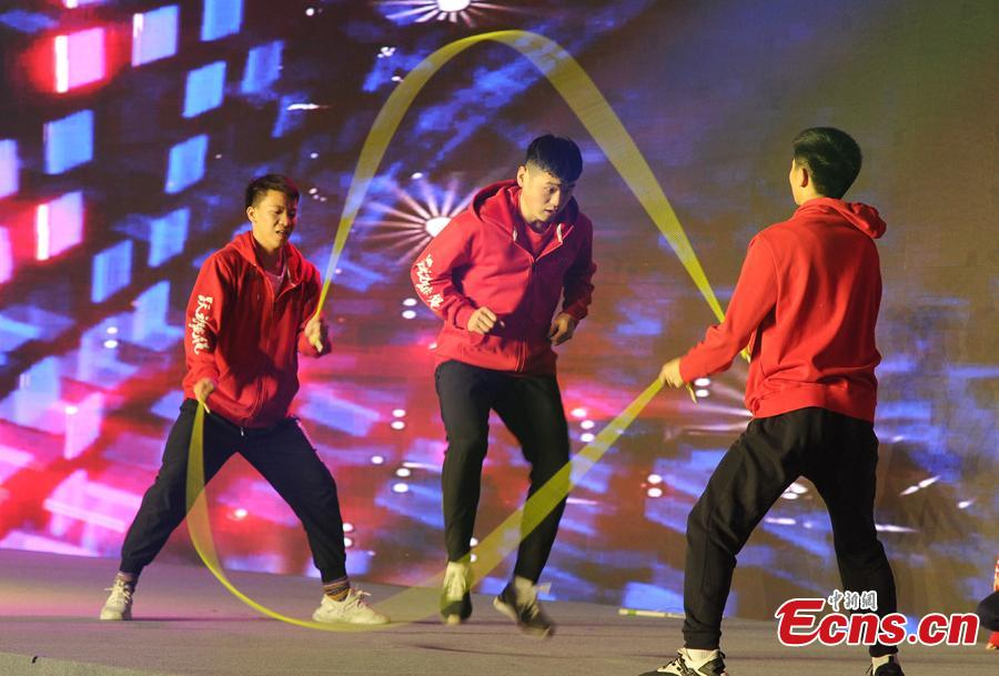 Contestants perform smart rope skipping at the finals of the First National Intelligent Sports Competition in Hangzhou, Zhejiang Province, Dec. 29, 2018. More than 1,400 finalists from across China will compete in 13 intelligent sports, including cycling, racing, golf, and shooting, in the following 2 days. (Photo: China News Service/Zhang Yin)