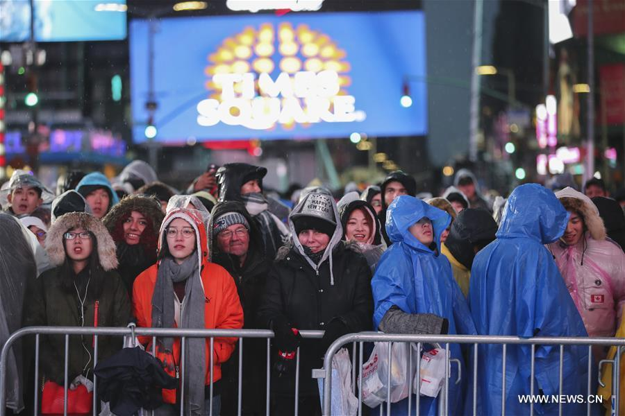 People wait for the New Year celebration on Times Square in New York, the United States, on Dec. 31, 2018. (Xinhua/Wang Ying)