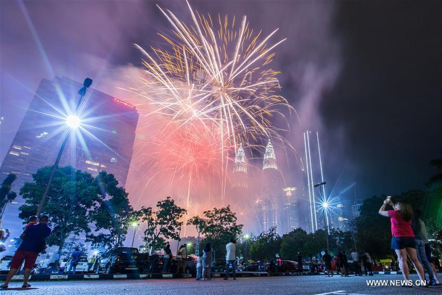 New Year fireworks are seen near the Petronas Twin Towers in Kuala Lumpur, Malaysia, on Jan. 1, 2019. (Xinhua/Zhu Wei)