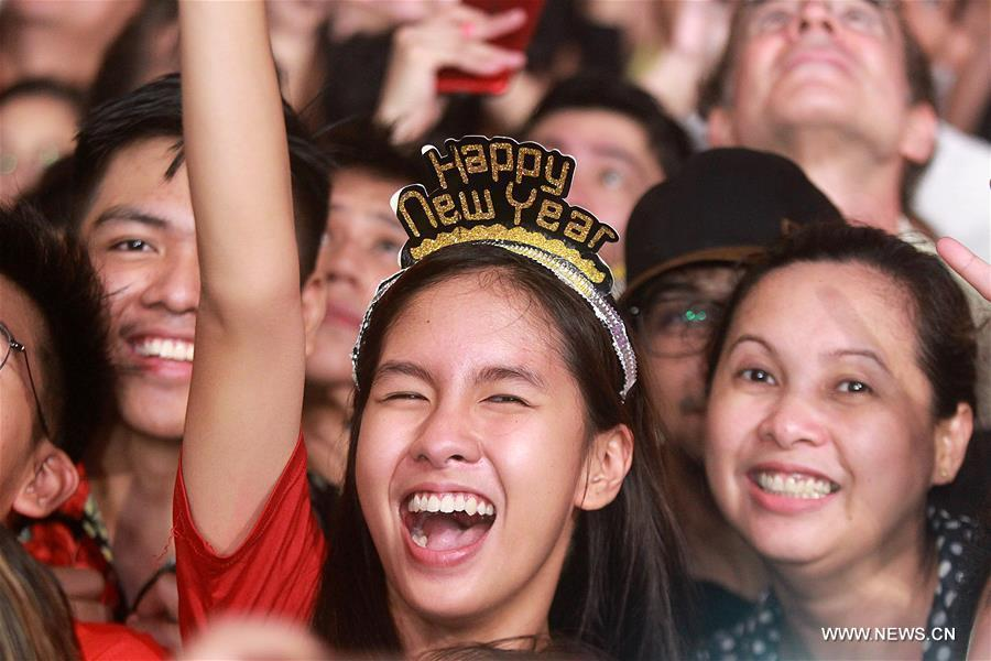 Revelers cheer during a New Year celebration at a park in Quezon City, the Philippines, on Jan. 1, 2019. (Xinhua/Rouelle Umali)